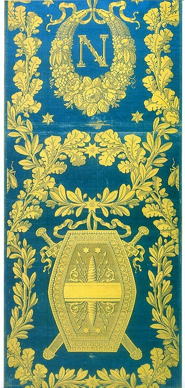 blue damask with a yellow border and a shield motif decoration